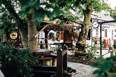 Flowers and tables in the beautiful beer garden at Fitzpatricks